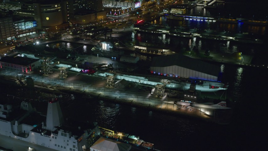6K stock footage aerial video of orbiting the USS Intrepid docked at Hell's Kitchen at Night in Midtown, NYC Aerial Stock Footage | AX123_006
