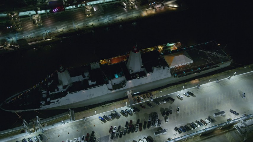 6K stock footage aerial video orbit and tilt to bird's eye of a Naval Warship at Hell's Kitchen docks at Night in Midtown, NYC Aerial Stock Footage | AX123_007