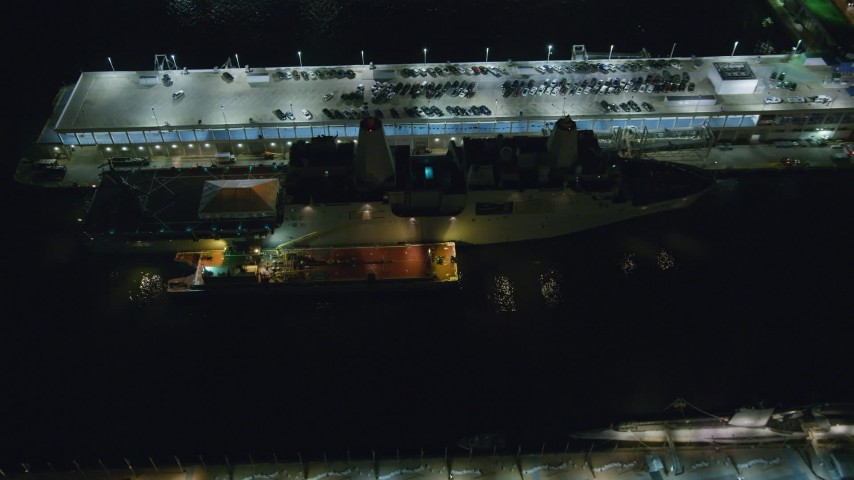 6K stock footage aerial video of a bird's eye of Naval warship docked at Hell's Kitchen at Night in Midtown, NYC Aerial Stock Footage | AX123_008
