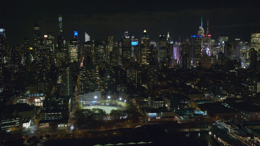6K stock footage aerial video orbit Midtown high-rises and De Witt Clinton Park at Night, New York City Aerial Stock Footage | AX123_012