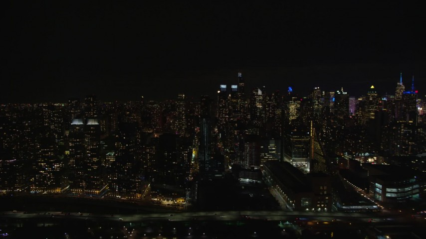 5.5K stock footage aerial video of Midtown Manhattan and Upper West Side skyscrapers at Night in New York City Aerial Stock Footage | AX123_013E