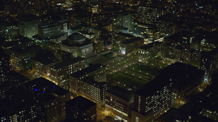6K stock footage aerial video of approaching Columbia University at Night in Morningside Heights, New York City Aerial Stock Footage | AX123_022
