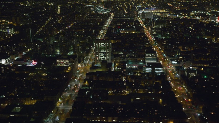 6K stock footage aerial video orbit 7th Avenue and Malcolm X Boulevard in Harlem at Night, New York City Aerial Stock Footage | AX123_025