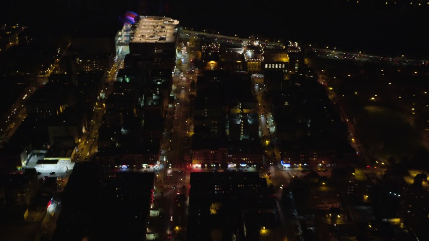 6K stock footage aerial video fly over Harlem streets and apartment buildings at Night in NYC Aerial Stock Footage | AX123_026
