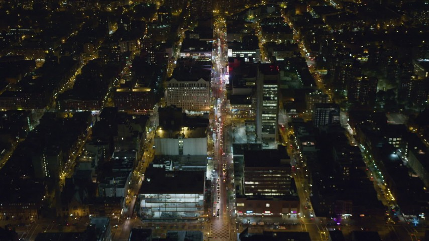 6K stock footage aerial video of flying over 125th Street in Harlem at Night in New York City Aerial Stock Footage | AX123_034