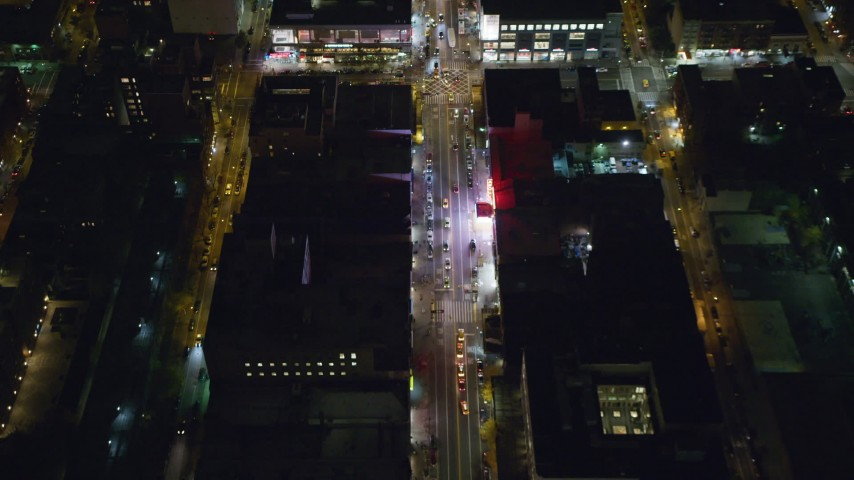 6K stock footage aerial video of tilting to a bird's eye view of 125th Street in Harlem at Night in New York City Aerial Stock Footage | AX123_036