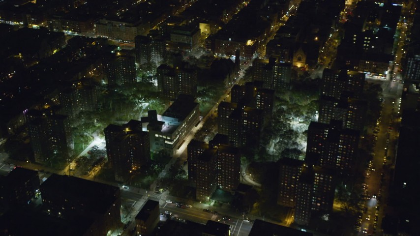 6K stock footage aerial video fly over public housing complex in Harlem at Night, New York City Aerial Stock Footage | AX123_039