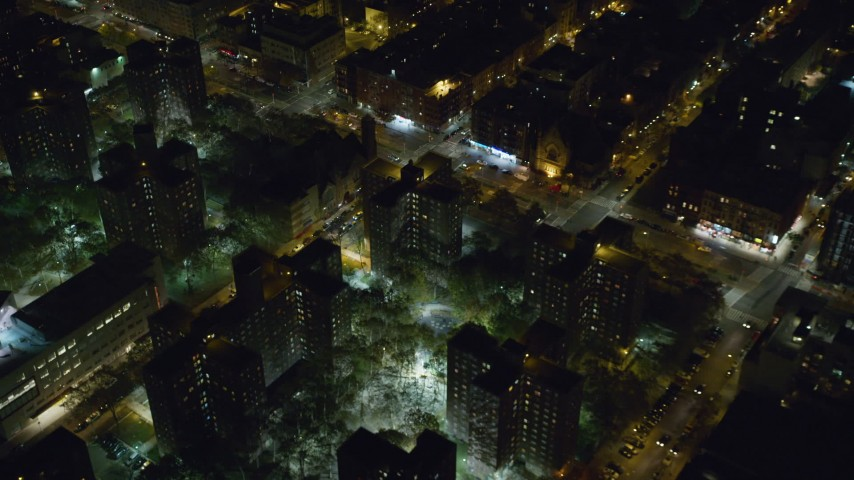 6K stock footage aerial video orbit public housing and streets at Night in Harlem, New York City Aerial Stock Footage | AX123_040