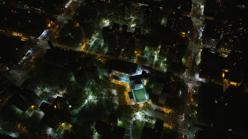 6K stock footage aerial video tilt to bird's eye of public housing complex in Harlem at Night, New York City Aerial Stock Footage | AX123_048