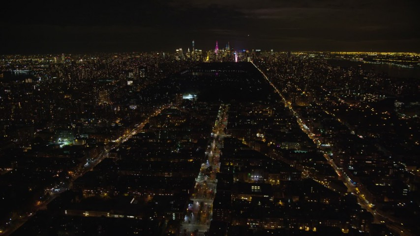 6K stock footage aerial video fly over 7th Avenue toward Central Park and Midtown at Night, New York City Aerial Stock Footage | AX123_049