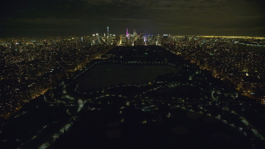 6K stock footage aerial video fly over Central Park and approach Midtown at Night in New York City Aerial Stock Footage | AX123_051