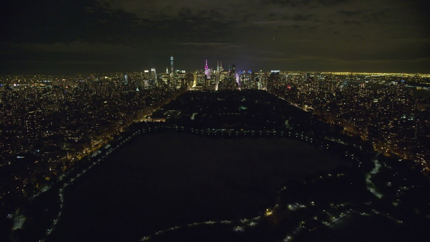 Fly Over Central Park and Approach Midtown Manhattan at Night Aerial Stock Footage | AX123_052