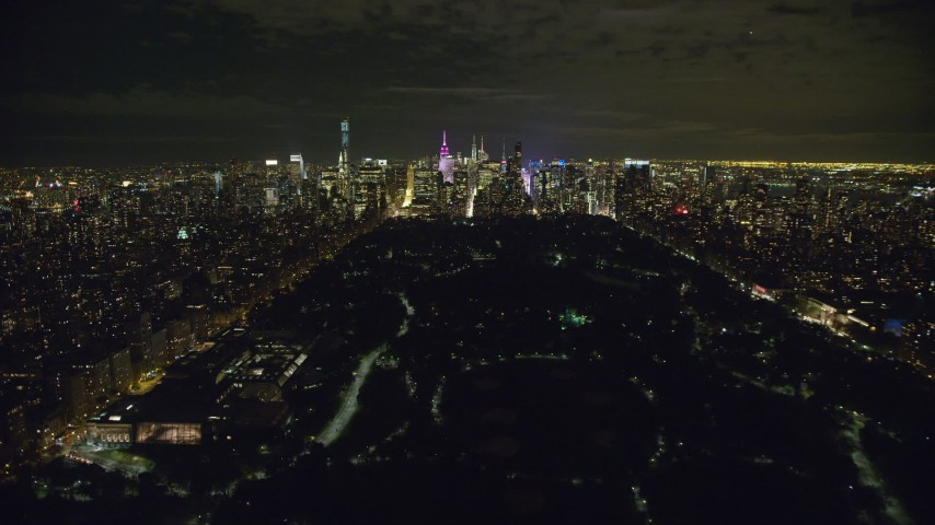 6K stock footage aerial video fly over Central Park in direction of Midtown at Night in New York City Aerial Stock Footage | AX123_054
