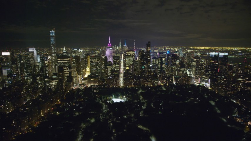 6K stock footage aerial video of approaching Midtown from Central Park at Nighttime in New York City Aerial Stock Footage | AX123_057