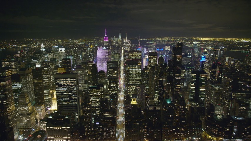 6K stock footage aerial video approach 6th Avenue and Midtown skyscrapers at Night in New York City Aerial Stock Footage   AX123_059