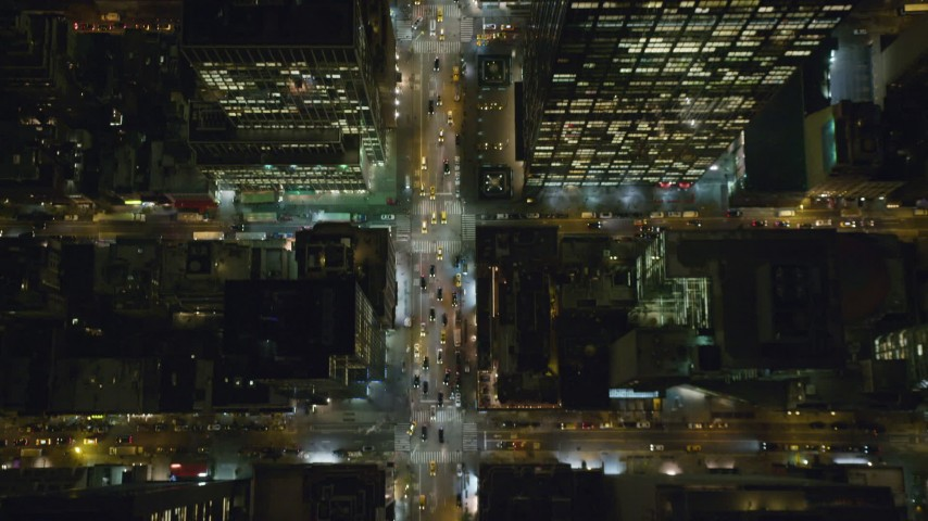 6K stock footage aerial video of a bird's eye of 6th Avenue in Midtown at Night in New York City Aerial Stock Footage | AX123_060