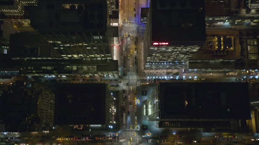 6K stock footage aerial video of a bird's eye view of 6th Avenue in Midtown at Night in New York City Aerial Stock Footage | AX123_061
