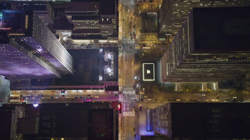 6K stock footage aerial video of a bird's eye of 6th Avenue in Midtown Manhattan at Night in New York City Aerial Stock Footage | AX123_062
