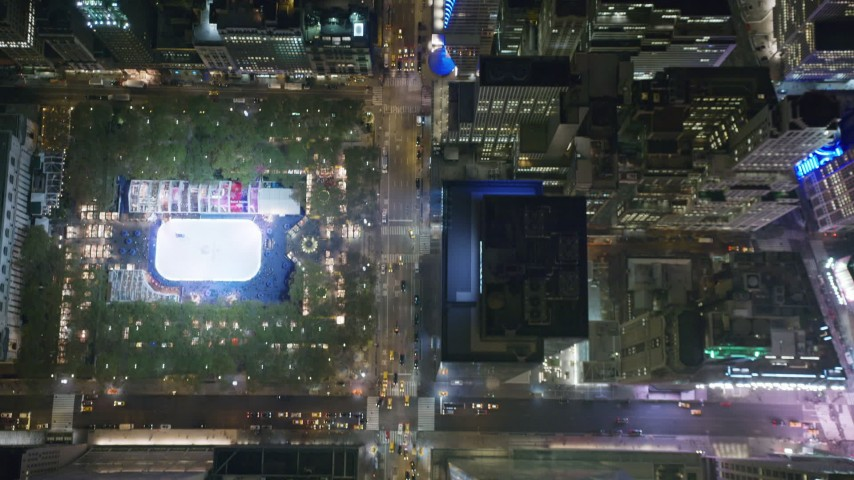 6K stock footage aerial video of a bird's eye of 6th Avenue in Midtown and reveal Bryant Park at Night Aerial Stock Footage | AX123_064