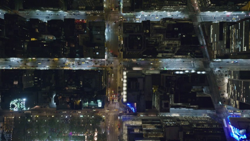 Bird's Eye of Bryant Park and 6th Avenue in Midtown at Night Aerial Stock Footage | AX123_065