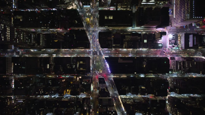 5.5K stock footage aerial video of a bird's eye of 6th Avenue and Broadway at Night in Midtown, New York City Aerial Stock Footage | AX123_066E