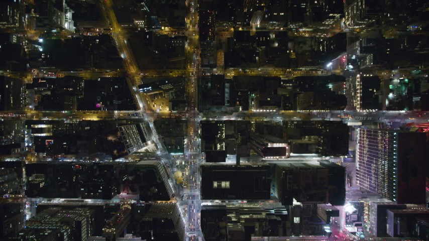 Bird's Eye of the 6th Avenue and Broadway Crossing in Midtown at Night Aerial Stock Footage | AX123_067