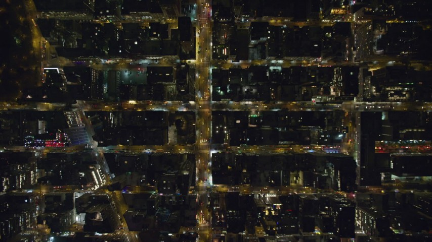 6K stock footage aerial video of bird's eye of 6th Avenue in Midtown at Nighttime in New York City Aerial Stock Footage | AX123_068