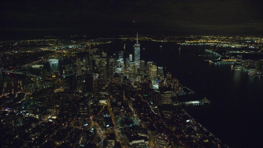 6K stock footage aerial video of Lower Manhattan skyscrapers at Nighttime in New York City Aerial Stock Footage | AX123_073