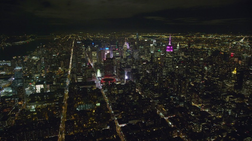 6K stock footage aerial video approach Madison Square Garden and Midtown skyscrapers at Night in New York City Aerial Stock Footage | AX123_075
