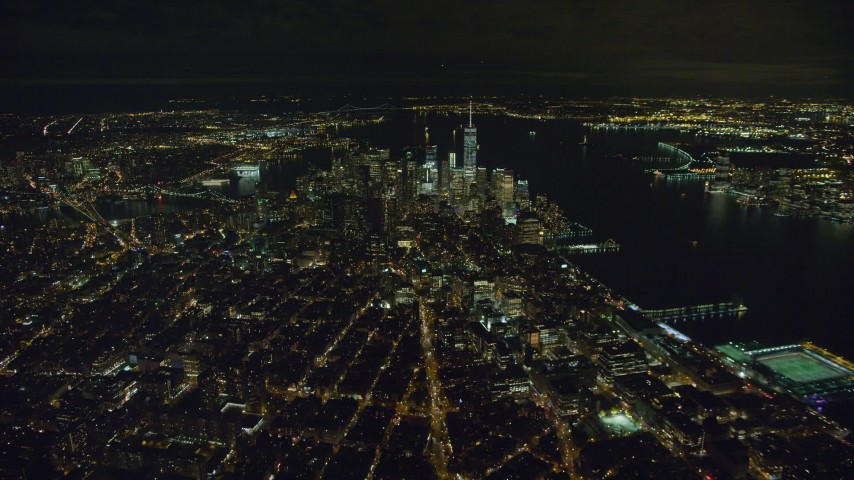 6K stock footage aerial video of approaching Lower Manhattan at Night in New York City Aerial Stock Footage | AX123_078