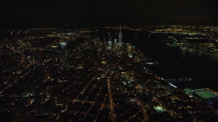5.5K stock footage aerial video of approaching Lower Manhattan at Night in New York City Aerial Stock Footage | AX123_078E
