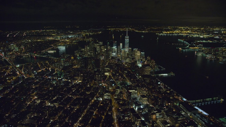 6K stock footage aerial video of flying toward Lower Manhattan at Night in New York City Aerial Stock Footage | AX123_079