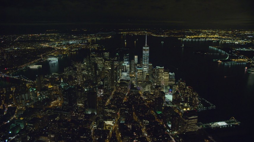 Approach to Lower Manhattan at Nighttime Aerial Stock Footage | AX123_081