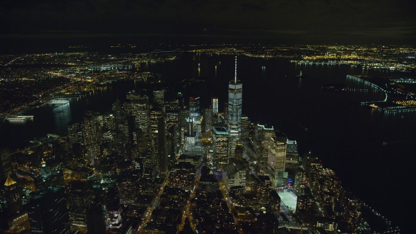6K stock footage aerial video of approaching One World Trade Center in Lower Manhattan at Night in New York City Aerial Stock Footage | AX123_082