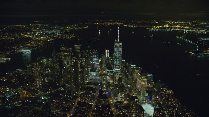 One World Trade Center in Lower Manhattan at Night Aerial Stock Footage | AX123_083