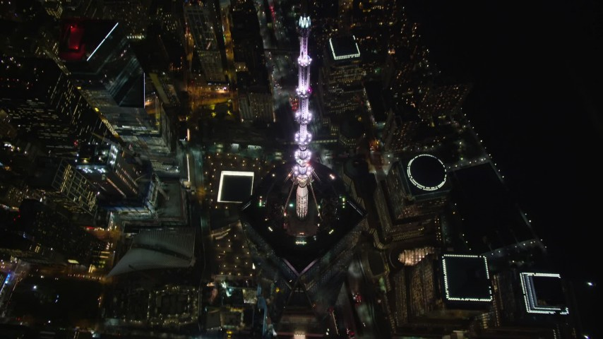 6K stock footage aerial video approach Freedom Tower and tilt to reveal the Memorial at Night, Lower Manhattan, NYC Aerial Stock Footage AX123_084 | Axiom Images