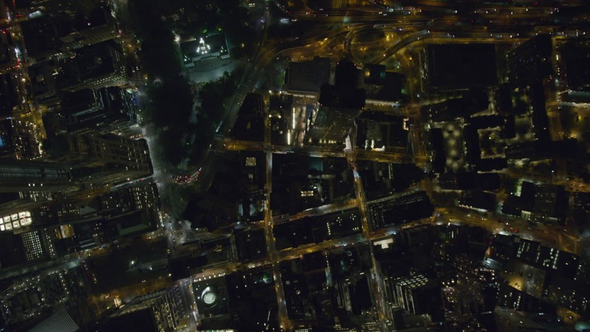 6K stock footage aerial video of a bird's eye view of streets and towers at Night in Lower Manhattan, New York City Aerial Stock Footage | AX123_088