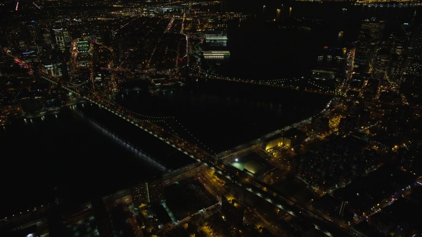 5.5K stock footage aerial video orbit of the Brooklyn and Manhattan Bridges at Night in New York City Aerial Stock Footage | AX123_090E