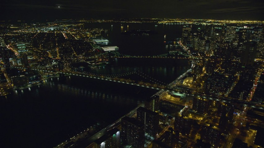 6K stock footage aerial video of orbiting the Brooklyn Bridge and the Manhattan Bridge at Night in New York City Aerial Stock Footage | AX123_092