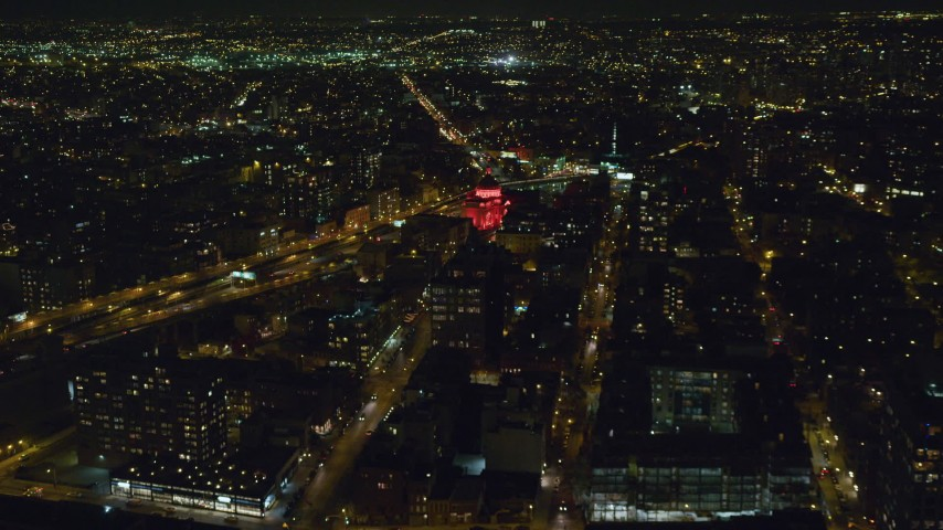 6K stock footage aerial video approaching the  Williamsburgh Savings Bank building at Night in Brooklyn, New York City Aerial Stock Footage | AX123_094