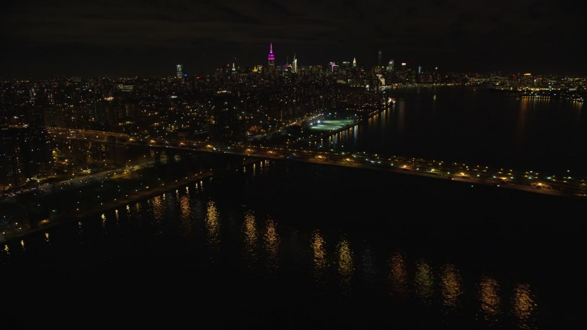 6K stock footage aerial video approach the Williamsburg Bridge at Night in New York City Aerial Stock Footage | AX123_099
