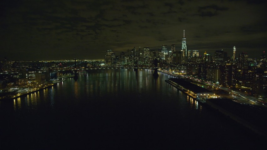 6K stock footage aerial video approach Manhattan Bridge and Lower Manhattan skyline at Night in New York City Aerial Stock Footage | AX123_101