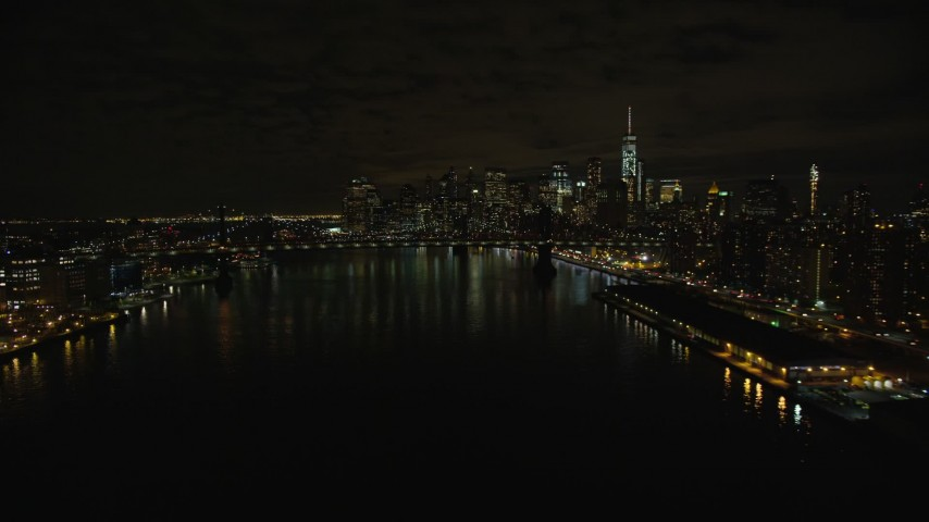 5.5K stock footage aerial video approach Manhattan Bridge and Lower Manhattan skyline at Night in New York City Aerial Stock Footage | AX123_101E