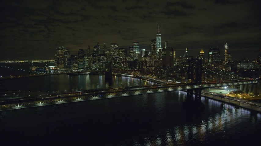 6K stock footage aerial video approach Manhattan and Brooklyn Bridges near Lower Manhattan at Night, NYC Aerial Stock Footage | AX123_103