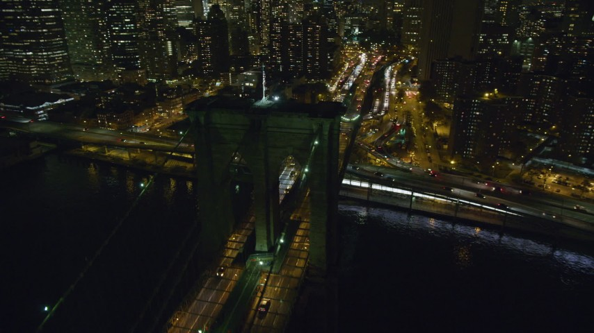 6K stock footage aerial video orbit the Manhattan side of the Brooklyn Bridge at Night in NYC Aerial Stock Footage | AX123_106