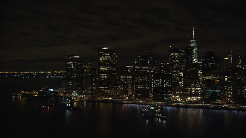 5.5K stock footage aerial video of riverfront skyscrapers in Lower Manhattan at Night in New York City Aerial Stock Footage   AX123_107E