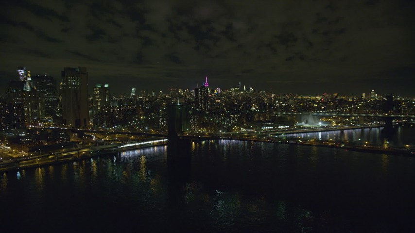 6K stock footage aerial video of an orbit of the Manhattan side of the Brooklyn Bridge at Night in New York City Aerial Stock Footage | AX123_110
