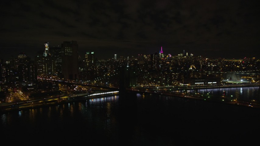 5.5K stock footage aerial video of an orbit of the Manhattan side of the Brooklyn Bridge at Night in New York City Aerial Stock Footage | AX123_110E