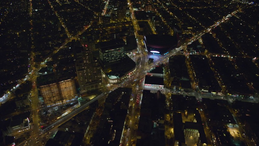 6K stock footage aerial video of the intersection of Atlantic and Flatbush Avenues by Barclays Center at Night, NYC Aerial Stock Footage AX123_121