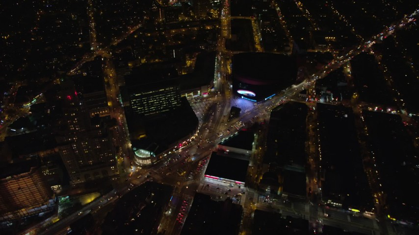 5.5K stock footage aerial video of the intersection of Atlantic and Flatbush Avenues by Barclays Center at Night, NYC Aerial Stock Footage | AX123_121E